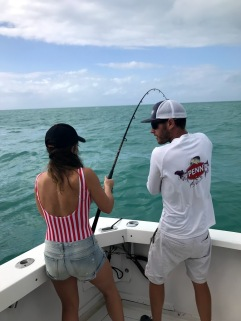 Aly Struggling to Haul in Her Baby Shark Catch.